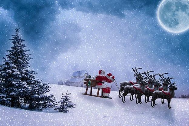 Santa Claus en trineo repartiendo regalos por todo el mundo